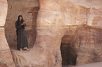 woman stands in petra cavern